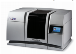 """Another new 3D printing company is on the scene. As of this week the Rize team is officially out of stealth mode, a milestone the company has been working towards since their founding in 2012. With a slew of additive manufacturing patents expiring over the last few years the competition for new machines has been fierce and to succeed something unique is required. There are a few areas of improvement possible, speed, ease of use, but also importantly in innovations not directly related to the printer hardware, that being in the software and the actual materials to be printed. Figure 1 - The Rize One is marketed as a desktop industrial printer that improves post processing time of 3D printed parts. The Rize One is an FDM (fused deposition modeling) machine billed as an office compatible desktop system. Starting at nearly $20,000 for a machine you can expect that will not just be any old desk. For Rize the potential innovation is in the material which, according to their press releases, allows for significantly reduced post-processing time by """"eliminating time-consuming support removal and producing a usable part 50% faster than other systems."""" The improvement is done through the use of, at this point, three independent materials. The proprietary Rizium One is the base thermoplastic of the part while Release One is a repellant that is jetted between the designed part and the support structure making it easier to break away. Marking Ink is also available which adds the ability to drop on simple logos and text, a process that is cumbersome on alternate machines, as it often must be done by hand painting. (Insert Video showing break away of material) Some other noted features are simply those of the additive manufacturing market in general, reduced time to market, cut costs, and streamlined operations but at least one, an improved software algorithm that allows for printing of imperfect files, holds some promise. Still the industry has been burned by lackluster features o"""